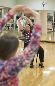 Candace H. Johnson-For Shaw Media Instructor Carol Kiraly, of McHenry and Lynn Henrichs, of Round Lake work on stretching exercises during Yoga for Seniors at the Robert W. Rolek Community Center in Round Lake.(2/20/18)