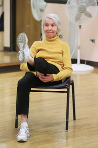 Candace H. Johnson-For Shaw Media Mary Hedges, of Lincolnshire works on stretching and strengthening her legs from a sitting position during Yoga for Seniors at the Robert W. Rolek Community Center in Round Lake.(2/20/18)