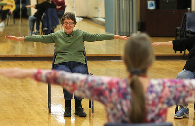 Candace H. Johnson-For Shaw Media Marcene Tekampe, of Grayslake watches Carol Kiraly, instructor, as they work on arm exercises during Yoga for Seniors at the Robert W. Rolek Community Center in Round Lake.(2/20/18)