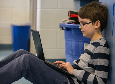 Whitney Rupp for Shaw Media Fifth-grader Jonathan Kruse, 10, works on a Chromebook in class Wednesday, Feb. 21.