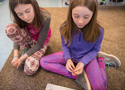 Whitney Rupp for Shaw Media Abigayle Manoso, left, 11, and Hayden Benedict, 10, take turns reading in their fifth-grade classroom Wednesday, Feb.21.