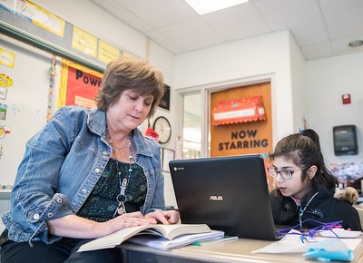 Whitney Rupp for Shaw Media Fifth-grade teacher Amy Varys works in her classroom with Nabiha Ahmed,10, on reading skills at Mary Endres Elementary in Woodstock Feb. 21.