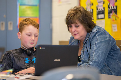 Whitney Rupp for Shaw Media  Mary Endres fifth-grade teacher Amy Varys works with Dillon Gavers, 10, in her classroom Wednesday, Feb. 21.