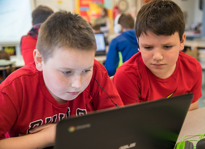 Whitney Rupp for Shaw Media Sean Buck, left, 11, works with classmate Jack Freeman, 11, on reading skills in their fifth-grade classroom Wednesday, Feb. 21.