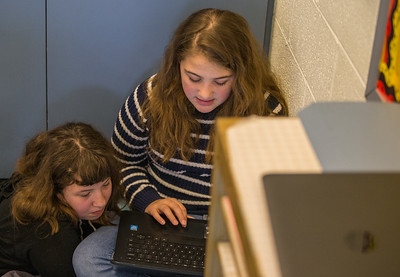 Whitney Rupp for Shaw Media Caroline Malicki, 11, left, and McKenna Vidales, 11, work together in their fifth-grade class at Mary Endres Elementary School in Woodstock Feb.21.