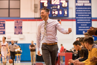 Whitney Rupp for Shaw Media Golden Eagles head coach Jimmy Roberts reacts after a score against Dundee-Crown Friday night.