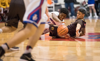 Whitney Rupp for Shaw Media Dundee-Crown's Trayvon Hatcher scrambles for a loose ball over Jacobs' Ajani Rodriguez during Jacobs' 51-42 victory Friday night.