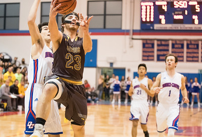 Whitney Rupp for Shaw Media Jacobs' Daniel Murray drives to the basket as the bulk of the Dundee-Crown Chargers look on Friday night.