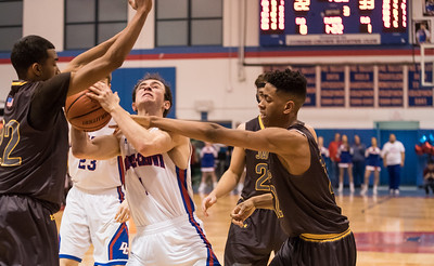 Whitney Rupp for Shaw Media Jack Orndahl, Dundee-Crown, frustrates Jacob's defense as he draws a foul Friday night.