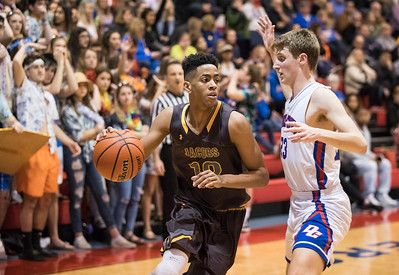Whitney Rupp for Shaw Media Kameron Mack of Jacobs works his way past Dundee-Crown's Brad Stec as Jacobs works their way past Dundee-Crown 51-42 Friday night.
