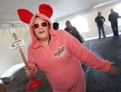 Candace H. Johnson-For Shaw Media Amber Rivera, of Antioch shows off her award for Best Individual Costume during the Polar Plunge at Lakefront Park in Fox Lake.(2/25/18)