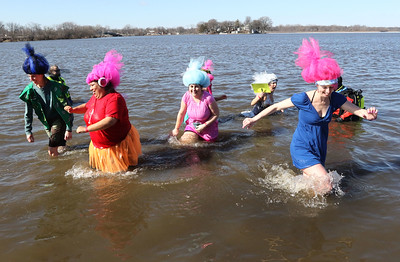 Candace H. Johnson-For Shaw Media The Lambs Farm Trollin' the Waters team makes their way through Nippersink Lake during the Polar Plunge at Lakefront Park in Fox Lake.