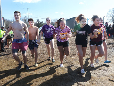 Candace H. Johnson-For Shaw Media The Richmond-Burton High School team run into the water during the Polar Plunge at Lakefront Park in Fox Lake.