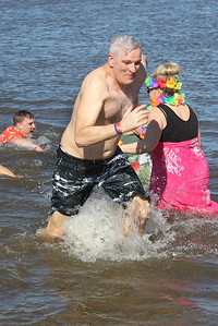 Candace H. Johnson-For Shaw Media Lake County Sheriff Mark Curran runs through the frigid water with his team, the Lake County Sheriff's Ice Breakers, during the Polar Plunge at Lakefront Park in Fox Lake.(2/25/18)