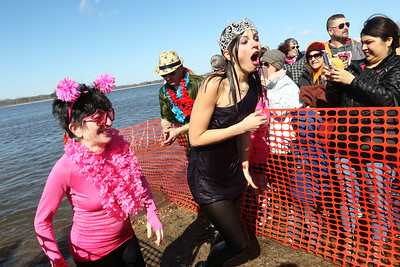 Candace H. Johnson-For Shaw Media Ant Simonian, of Libertyville and Miss Fox Lake Hailey Hill run out of the water during the Polar Plunge at Lakefront Park in Fox Lake. Simonian was at the event with the Lake County Sheriff's Ice Breakers team. (2/25/18)
