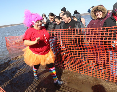 Candace H. Johnson-For Shaw Media Toni Castillo, of Round Lake with the Lambs Farm Trollin' the Waters team makes her way out of the water to dry land during the Polar Plunge at Lakefront Park in Fox Lake.