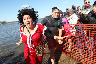Candace H. Johnson-For Shaw Media Lori Smith and Andrew Blessing, both of Mundelein with the Mundelein 5.0 (Saturday Night Live) team run out of the water during the Polar Plunge at Lakefront Park in Fox Lake.The Mundelein 5.0 team came in first place in the costume contest and with twenty members raised over nine thousand dollars for the Special Olympics.