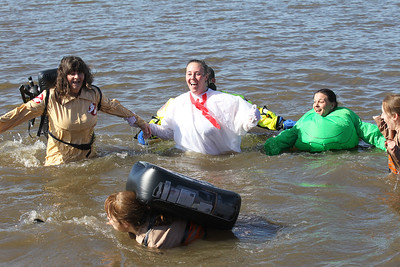 Candace H. Johnson-For Shaw Media The Fox Lake Dust Bunnies team dressed as Ghostbusters make their way through the water during the Polar Plunge at Lakefront Park in Fox Lake.(2/25/18)