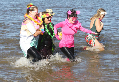 Candace H. Johnson-For Shaw Media Cortinie Sasman, Wilma Evaristo, Ari Briskman, Ant Simonian, and Mari Casillas, all the the Lake County Sheriff's Ice Breakers team make their way through the frigid water during the Polar Plunge at Lakefront Park in Fox Lake.(2/25/18)