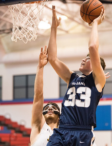 Whitney Rupp for Shaw Media Cary-Grove's Frank Jakubicek takes a shot just outside the reach of Jacobs' Daniel Murray at the Class 4A Regional Tuesday.