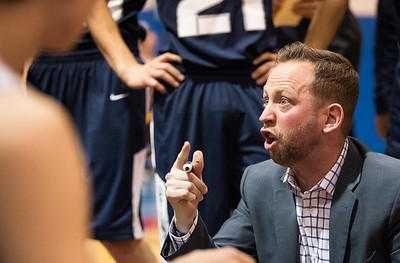 Whitney Rupp for Shaw Media Adam McCloud, head coach of the Cary-Grove Trojans, intensely speaks to his team during a time-out in the second quarter of the Dundee-Crown Class 4A Regional Tuesday.