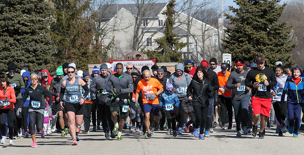Candace H. Johnson-For Shaw Media Runners take off on Municipal Way during the Frosty Footrace 5K Run/Walk at the Round Lake Area Park District Sports Center in Round Lake Beach. (2/25/18)