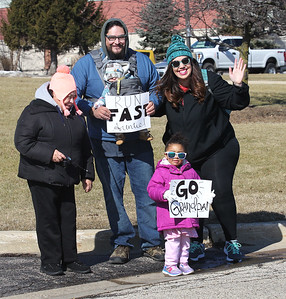 Candace H. Johnson-For Shaw Media Rosario Cardenas, of Round Lake Beach, Luis Cardenas, of Lake Bluff and his family, wife, Amanda, and baby Hugo, three-months-old, and Cataleya Ortiz, 2, of Round Lake show their support for their family members running in the Frosty Footrace 5K Run/Walk at the Round Lake Area Park District Sports Center in Round Lake Beach. (2/25/18)