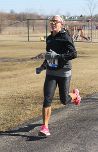 Candace H. Johnson-For Shaw Media Pam Staton, of Ingleside runs past the playground on route to first place during the Frosty Footrace 5K Run/Walk at the Round Lake Area Park District Sports Center in Round Lake Beach. Staton's time was 18:56.(2/25/18)