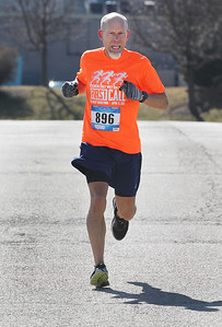 Candace H. Johnson-For Shaw Media Garrett Sillanpaa, of Kenosha, Wis., heads to the finish line to place second, first male to get to the finish line, on Municipal Way during the Frosty Footrace 5K Run/Walk at the Round Lake Area Park District Sports Center in Round Lake Beach.Sillanpaa's time was 20:26. (2/25/18)
