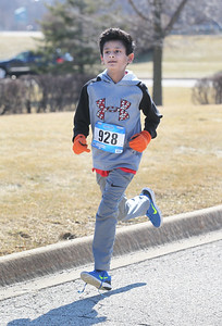 Candace H. Johnson-For Shaw Media Darren Pinto, 10, of Round Lake gets close to the finish line during the Frosty Footrace 5K Run/Walk at the Round Lake Area Park District Sports Center in Round Lake Beach. (2/25/18)