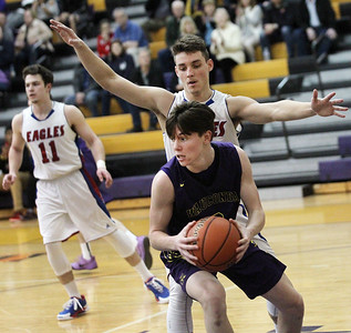 Candace H. Johnson-For Shaw Media Wauconda's Nicholas Bulgarelli pulls down a rebound against Lakes Brad Cherry in the fourth quarter during the Class 3A regional semi-final game at Wauconda High School. Wauconda won 52-51. (2/27/18)