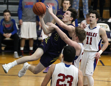 Candace H. Johnson-For Shaw Media Wauconda's Nicholas Bulgarelli leaps up for a shot against Lakes Ethan Greenfield, Tylor Gunther and Michael Behrendt in the second quarter during the Class 3A regional semi-final game at Wauconda High School. Wauconda won 52-51. (2/27/18)