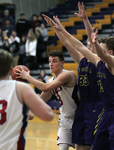 Candace H. Johnson-For Shaw Media Lakes Brad Cherry looks to pass against Wauconda's Andrew Nolan and his brother, Matthew, during the Class 3A regional semi-final game at Wauconda High School. Wauconda won 52-51. (2/27/18)