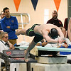 Marmion's Sam Wehrli dives off the blocks during the 50-yard freestyle during the state finals at Evanston High School on Feb. 24.