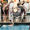 Lyons Township's 200-yard medley relay celebrate as they swam the second fastest time during state swimming and diving finals at Evanston Township High School on Feb. 24.
