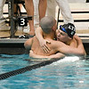 Lyons Township's Henry Claesson (right) and Hinsdale Central's Donovan Lahmann hug after the 200-yard freestyle event during the state swimming and diving finals in Evanston on Feb. 24.