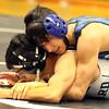 Geneva's Honor Nguyen wrestles for the 126-pound third place against Glenbard West's Will Om-Feld at the Glenbard East regional on Feb. 3. Nguyen won by fall.