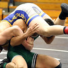 Wheaton North's Ben Lemp wrestles for the 145-pound third place at the Glenbard East regional on Feb. 3. Lemp won 3-0.