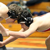 Glenbard East's Emiliano Garcia, right, wrestles for the 138-pound third place at the Glenbard East regional on Feb. 3. Garcia lost 9-3.