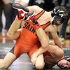 St. Charles East's Ben Anderson wrestles for the 120-pound championship with Glenbard East's Reese Martin at the Glenbard East regional on Feb. 3. Anderson won by fall.