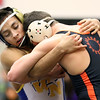 Wheaton North's Jaime Suarez wrestles for the 126-pound championship at the Glenbard East regional on Feb. 3. Suarez won by fall.