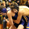 Wheaton North's Brice Balosky, right, wrestles for the 113-pound third place against Geneva's Ian Huck at the Glenbard East regional on Feb. 3. Balosky won 5-4 in overtime.