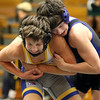 Geneva's Ian Huck, right, wrestles with Wheaton North's Brice Balosky for the 113-pound third place at the Glenbard East regional on Feb. 3. Huck lost 5-4 in overtime.