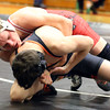 Glenbard East's Nick Guthrie wrestles for the 132-pound third place at the Glenbard East regional on Feb. 3. Guthrie won 7-3.