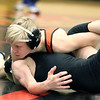 St. Charles East's Jake Penzato wrestles for the 106-pound championship at the Glenbard East regional on Feb. 3. Penzato won by fall.