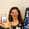 St. Charles East High School student Kayla Hart poses for a photo with some Olympic-themed props during a Workplace Olympics for special education students. The event featured events showcasing job skills such as packing boxes and filing papers.