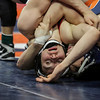 Oswego 's Gannon Hughes flips Yorkville's Joe Roberts on Saturday, Feb. 17, 2018, at the State Farm Center during Class 3A State Wrestling Finals in Champaign, Ill.