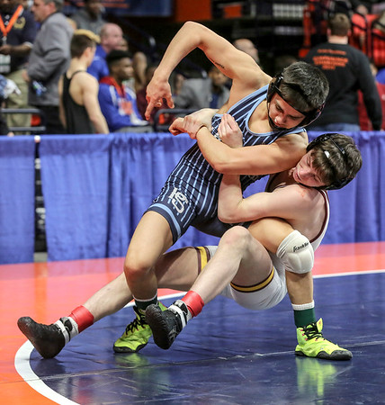 Montini's Dylan Ragusin brings down Plainfield South's Enzo Silva on Friday, Feb. 16, 2018, at the State Farm Center  during Class 3A State Wrestling Semifinals in Champaign, Ill.