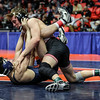 Yorkville's Joe Roberts tops Oswego's Gannon Hughes on Saturday, Feb. 17, 2018, at the State Farm Center during Class 3A State Wrestling Finals in Champaign, Ill.