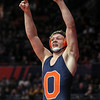 Oswego's Allen Swanson celebrates defeating Providence Catholic's Cole Smith on Saturday, Feb. 17, 2018, at the State Farm Center during Class 3A State Wrestling Finals in Champaign, Ill.